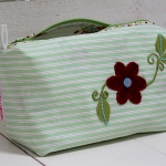 Green with embroidered flower in felt